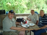 Renard Galus, Len VanDer Stad, and Ron Smolen catch up while eating.