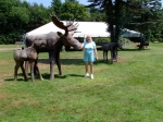 Janice Johns MacDougall celebrating her 70th birthday in VT. with some wooden creatures.