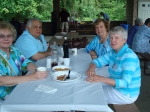 Helle De Palma, Sal and Mary Manfre Barbagallo, and Terry Coffey Mullins relax after eating.